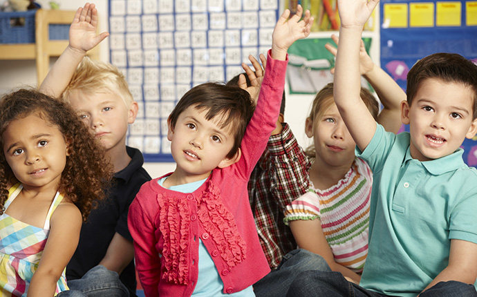 Children with hands in air