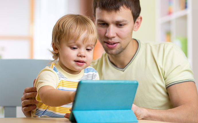 Man and child on tablet