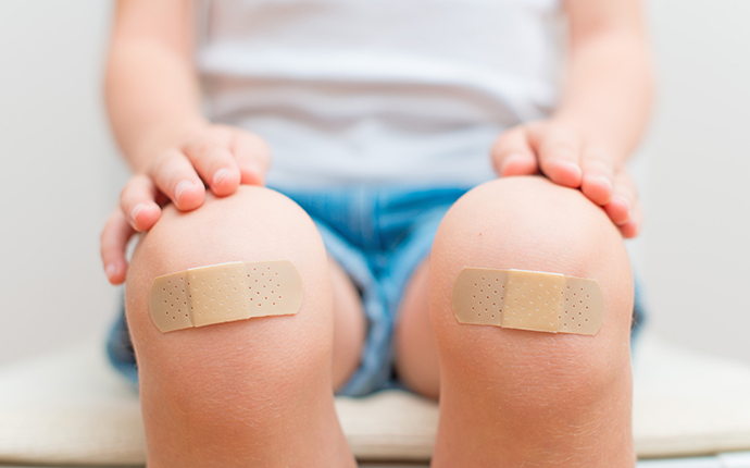 Plasters on child's knees